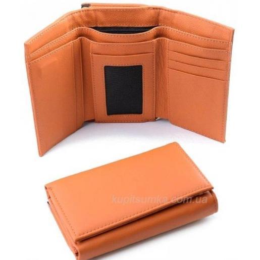 Компактный кожаный кошелек желтого цвета на магнитных кнопках