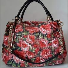 Женская сумка из кожзаменителя розового цвета